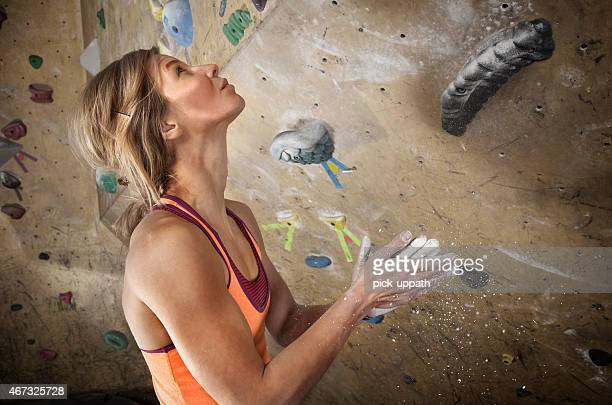 Woman Indoor Climbing Removes Chalk From Hand
