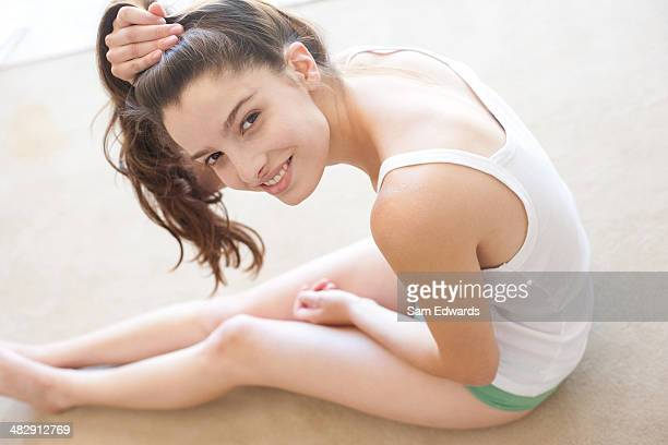 woman indoors putting hair up - 18 19 years stock pictures, royalty-free photos & images