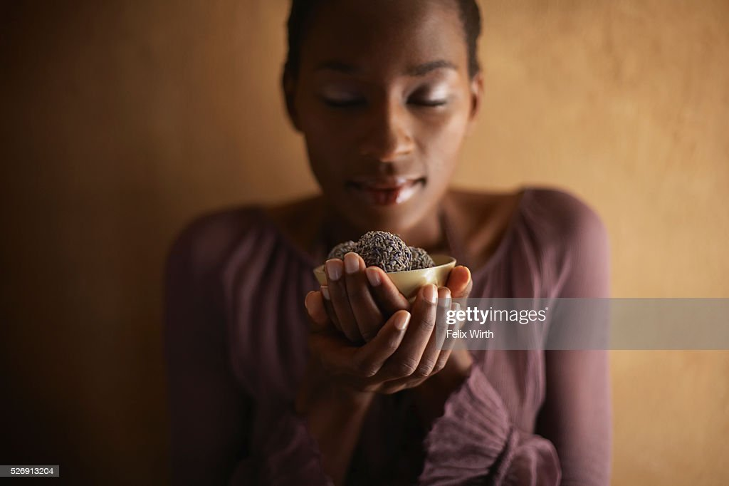 Woman indulging in chocolates : ストックフォト