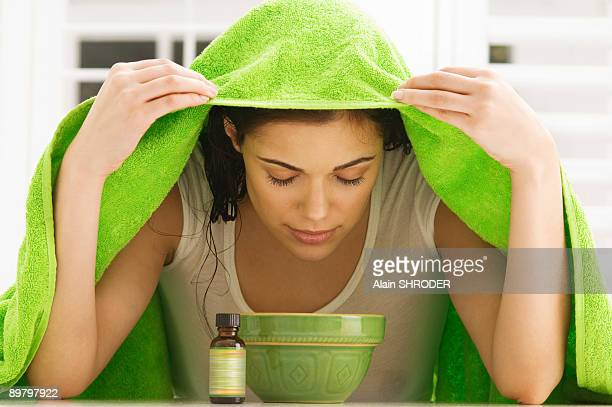 woman inhaling over a bowl - moving activity stock pictures, royalty-free photos & images