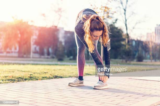 woman injuring foot while training - sprain stock pictures, royalty-free photos & images