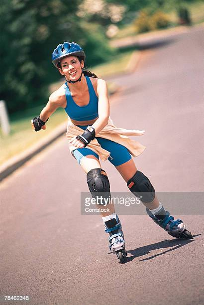 Woman inline skating on road