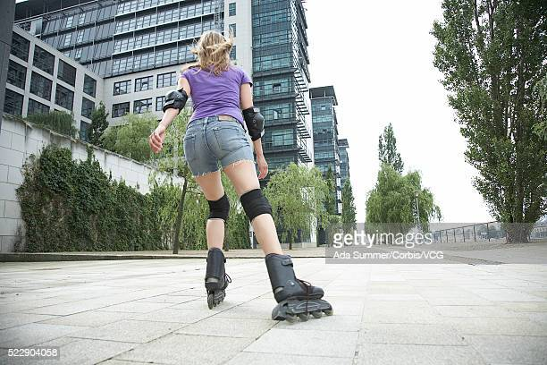 Woman inline skating through a city