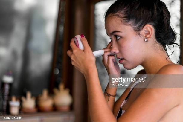 woman  inserting contact lenses - contact lens stock pictures, royalty-free photos & images
