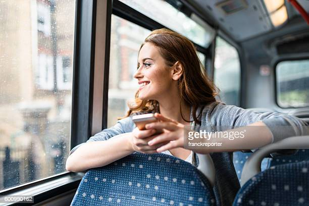 woman inside a bus in london on the phone - autocarro imagens e fotografias de stock