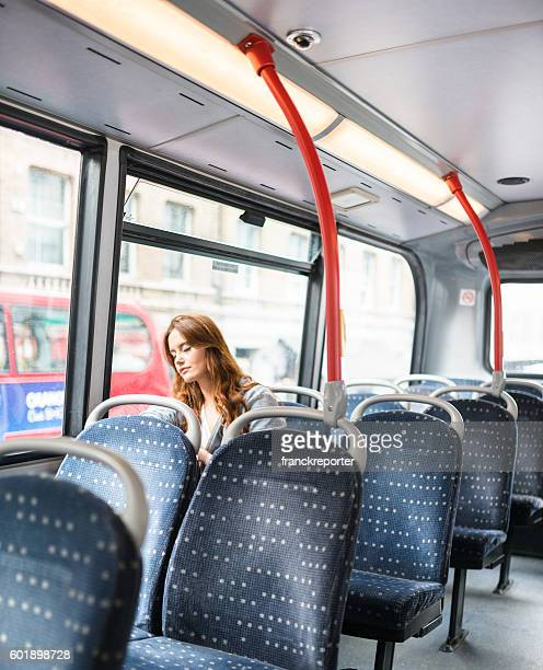 woman inside a bus in london travel alone