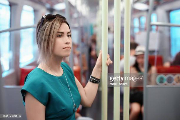 woman inside bus thinking - 30 34 years stock pictures, royalty-free photos & images