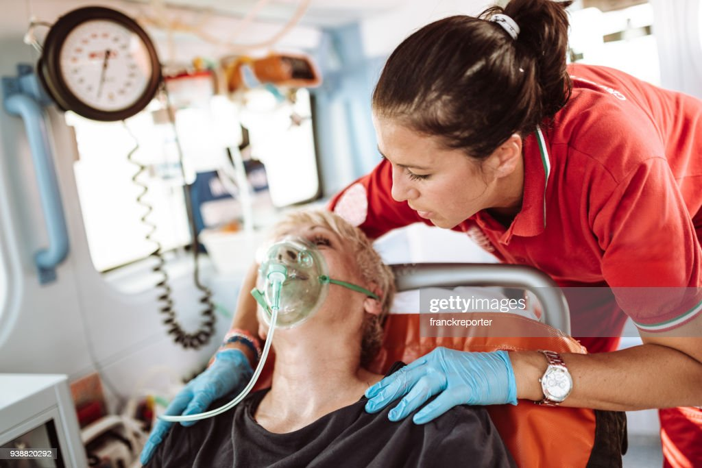 woman inside the ambulance : Stock Photo