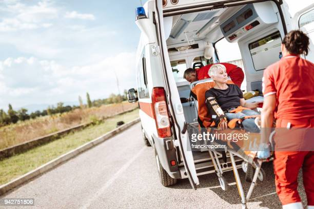 woman inside the ambulance - bloody car accidents stock pictures, royalty-free photos & images