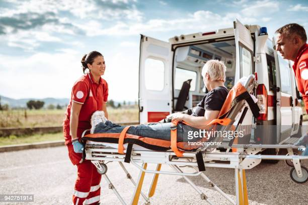 woman inside the ambulance - emergency medicine stock pictures, royalty-free photos & images