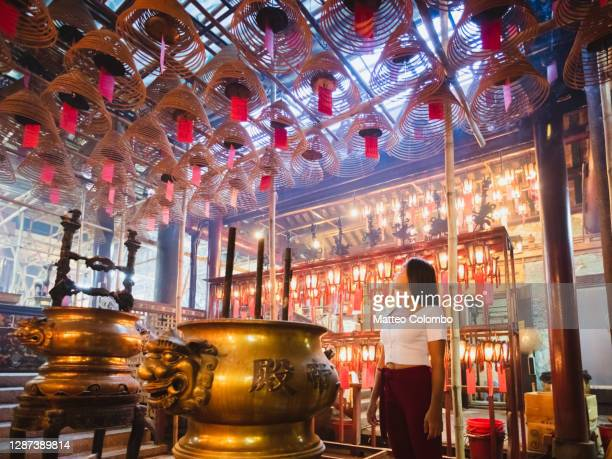 woman insode man mo temple, hong kong, china - incense coils stock pictures, royalty-free photos & images