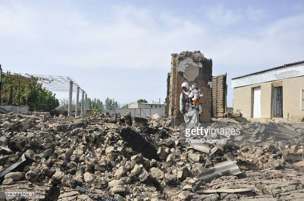 Woman inspects ruins of a demolished building on Kyrgyz side after last week's clashes at a disputed section of the Kyrgyzstan-Tajikistan border, in...