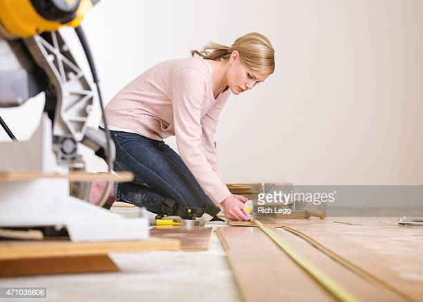 woman installing laminate flooring - measuring stock photos and pictures