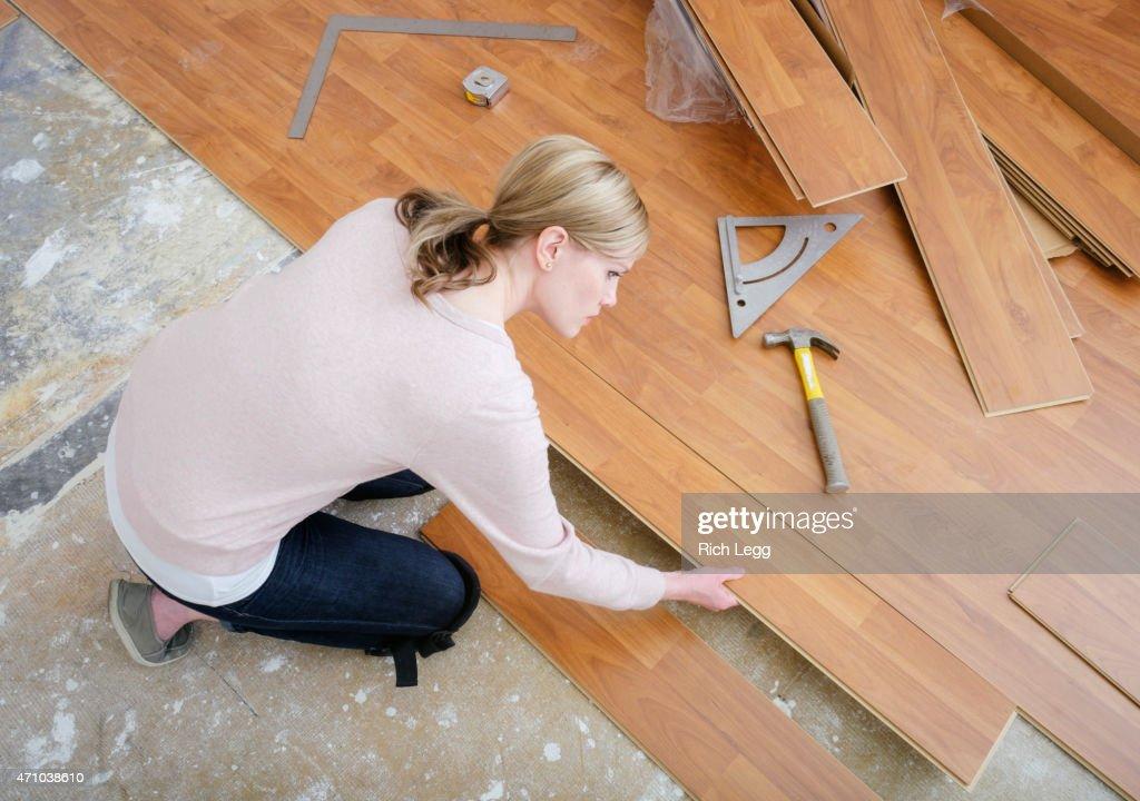 Woman Installing Laminate Flooring : Stock Photo