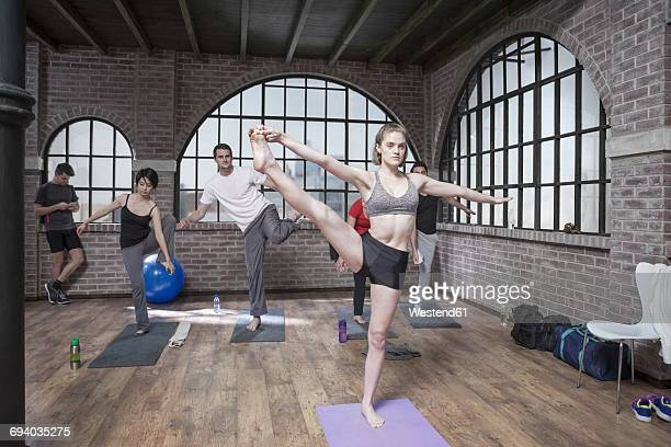 Woman instructing yoga class