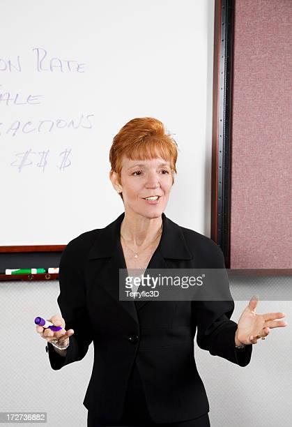 woman instructor explaining business finance concept to class - terryfic3d bildbanksfoton och bilder