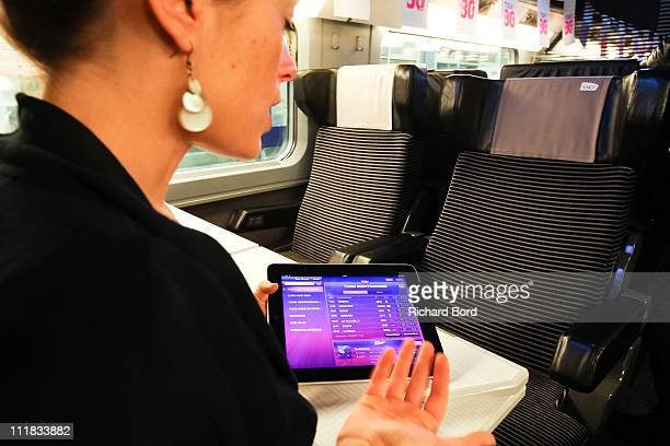 A woman introduces the new SNCF app for iPad during the SNCF presentation at Gare Montparnasse on April 7 2011 in Paris France French train company...