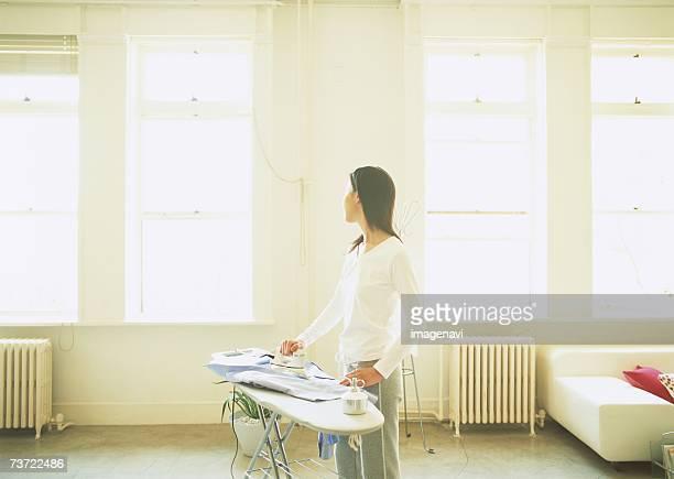 Woman ironing a shirt
