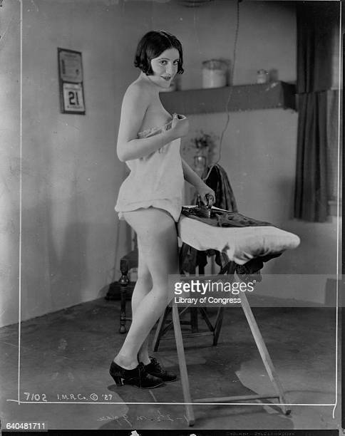 Woman Ironing in Lingerie