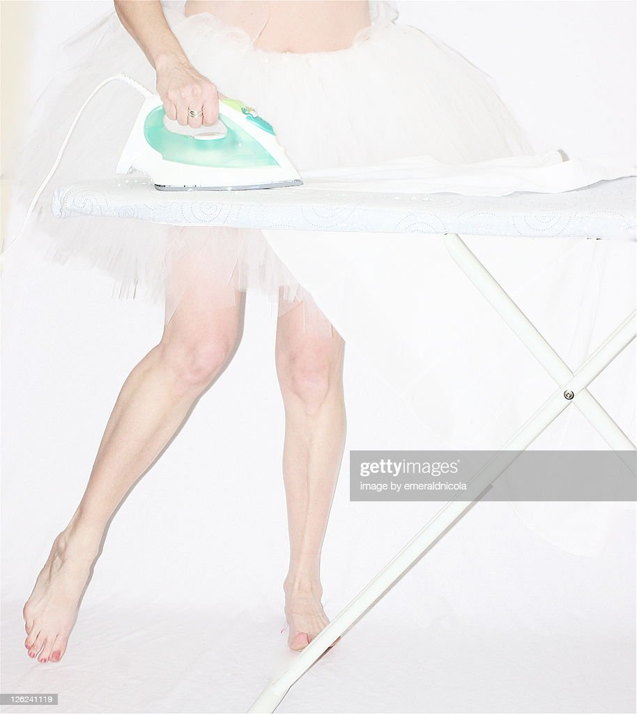 Woman ironing in white tutu : Stock Photo