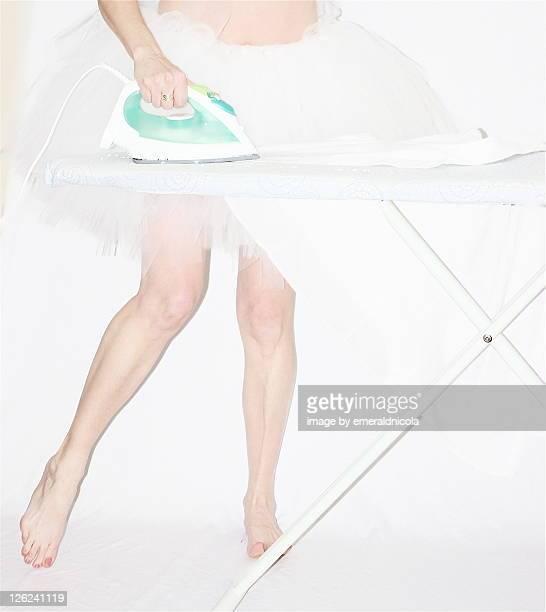 Woman ironing in white tutu