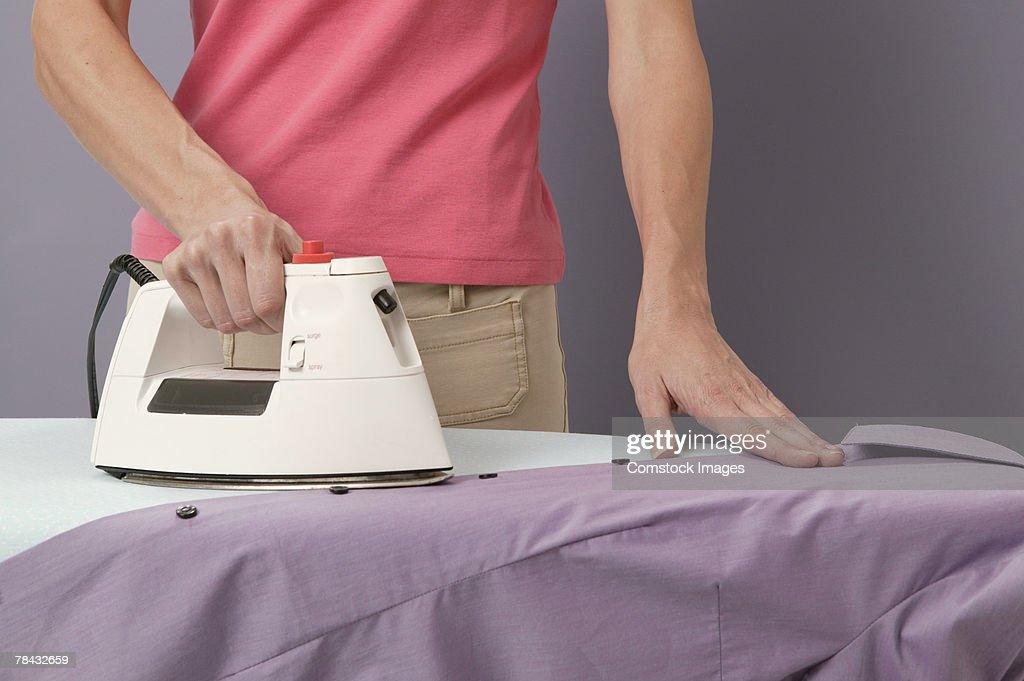 Woman ironing : Stockfoto