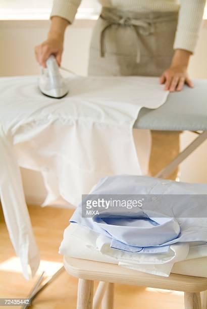 A woman ironing shirt