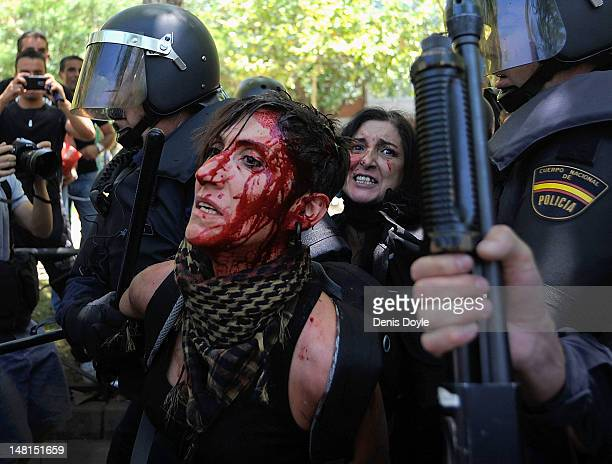 A woman is arrested by riot police during a demonstration by Spanish coal miners on July 11 2012 in Madrid Spain The miners had marched to Madrid in...
