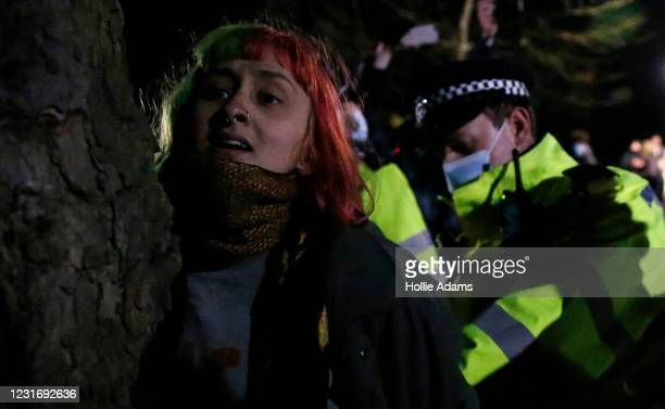 Woman is arrested during a vigil for Sarah Everard on Clapham Common on March 13, 2021 in London, United Kingdom. Vigils are being held across the...