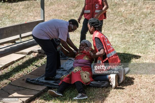 A woman is assisted by Red Cross Kenya staff at the Chiromo mortuary where are kept the bodies of the victims of an Islamist attack two days prior at...
