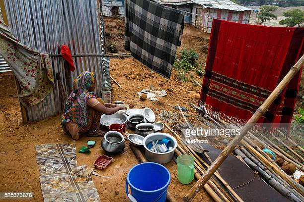 A woman is cleaning her utensils inside stone workers' village on April 4 2015 in Jaflong Sylhet Bangladesh Stone workers live a miserable life in...