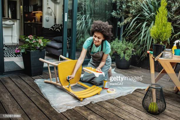 woman is coloring a chair at home - craft product stock pictures, royalty-free photos & images