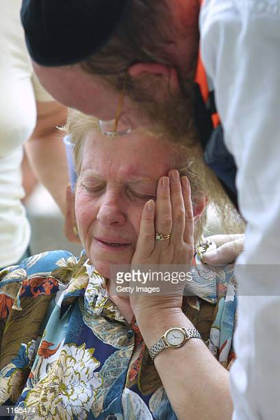 A woman is comforted by a medic after an explosion at Hebrew University July 31 2002 in Jerusalem Israel Israeli authorities say that a planted bomb...