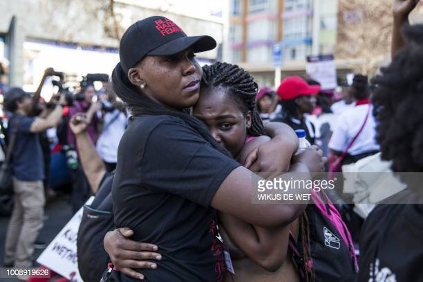 A woman is comforted by another woman during a march gathering women in Pretoria who are demanding sustainable action against genderbased violence...