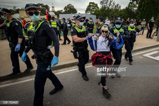 A woman is detained by members of Victoria Police on October 23 2020 in Melbourne Australia Protesters are calling on the end to lockdown...