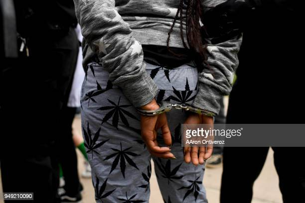 A woman is detained for public consumption of marijuana during 4/20 festivities at Denver's Civic Center Park on Friday April 20 2018 When asked how...