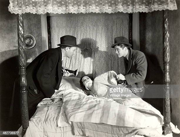 A woman is discovered bound and gagged in a scene from the film 'The Famous Ferguson Case' 1932