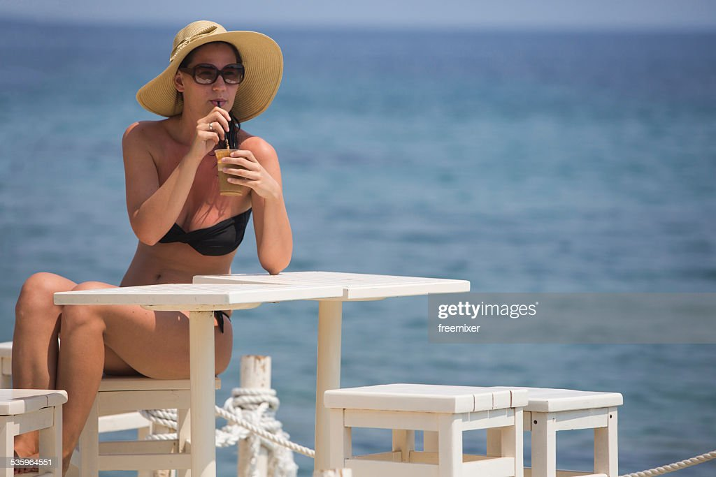 Woman is drinking coffee and enjoy the beautiful seascape : Stock Photo