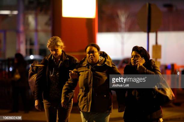 A woman is escorted outside Mercy Hospital after a gunman shot multiple people on November 19 2018 in Chicago Illinois Three people including Chicago...