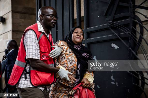 A woman is evacuated from the scene of an explosion at a hotel complex in Nairobi's Westlands suburb on January 15 in Kenya The AlShabaab Islamist...