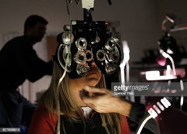 A woman is given an eye exam at a vision clinic at the Remote Area Medical mobile dental and medical clinic on December 4 2016 in Milton Florida More...