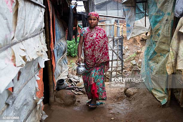 A woman is going back to her house from the toilets inside stone workers' village on April 4 2015 in Jaflong Sylhet Bangladesh Stone workers live a...