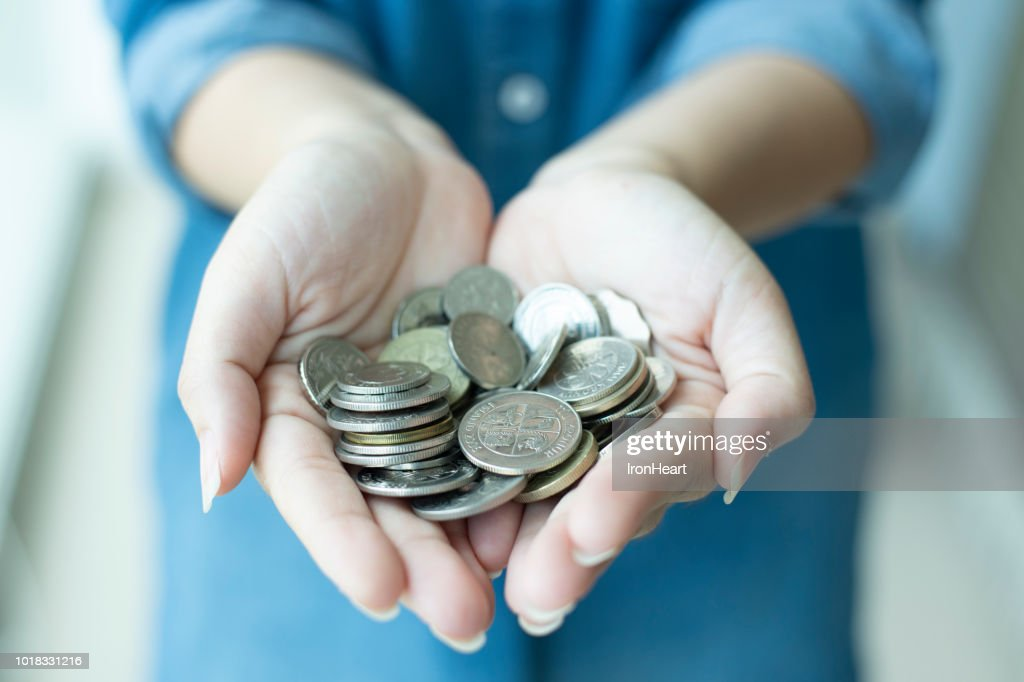 Woman is hand on coins as for saving money. : Stock Photo
