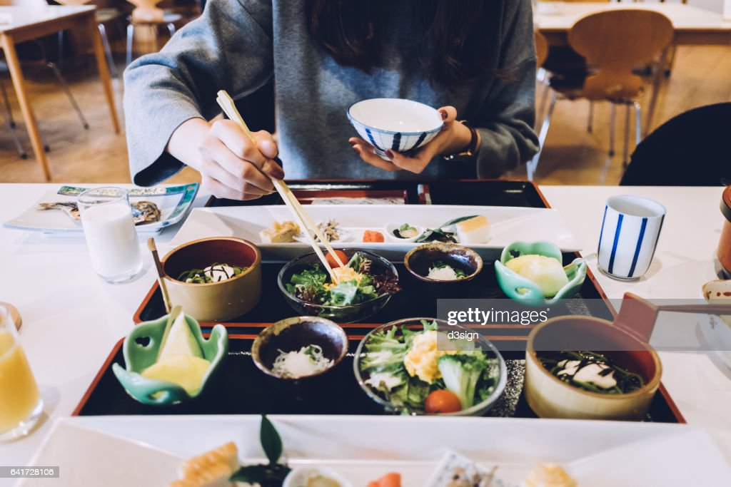 Woman is having meal in a Japanese restaurant : Stock Photo