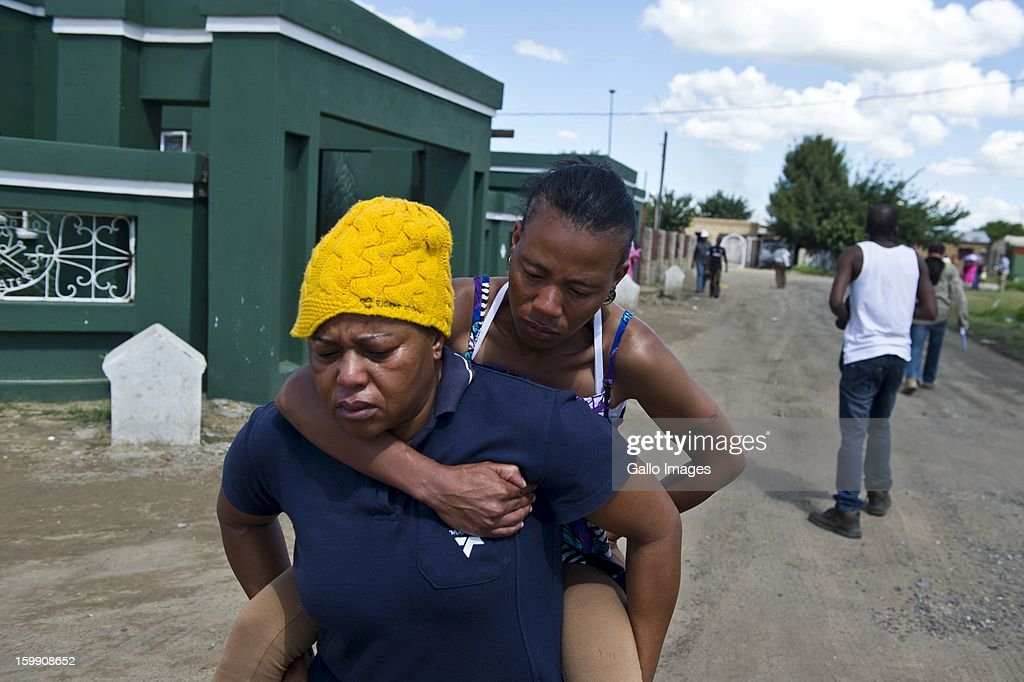 A woman is hit by a rubber bullet on January 22, 2013, in Sasolburg, South Africa. Government's announcement of its intention to merge municipal systems in the Free State sparked outrage in locals, leading to chaotic protests.
