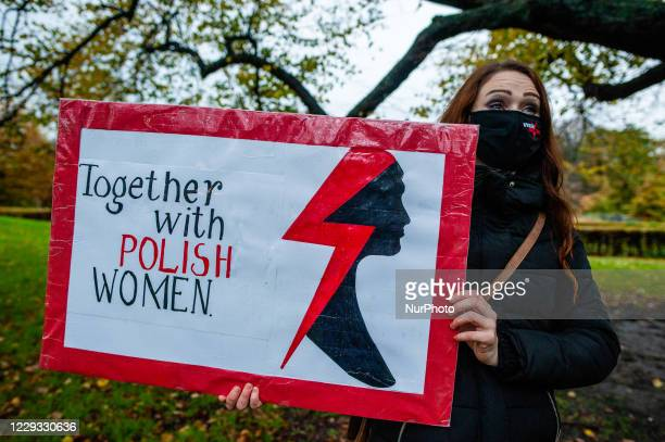 Woman is holding a placard in solidarity with Polish women, during the protest against the abortion ban In Poland, that took place in The Hague, on...