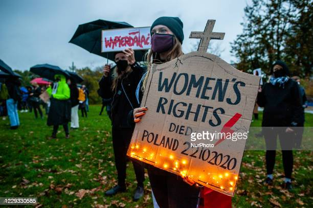 Woman is holding a placard with lights, in solidarity with Polish women, during the protest against the abortion ban In Poland, that took place in...