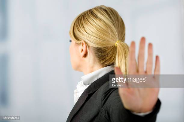 A woman is holding her hand up