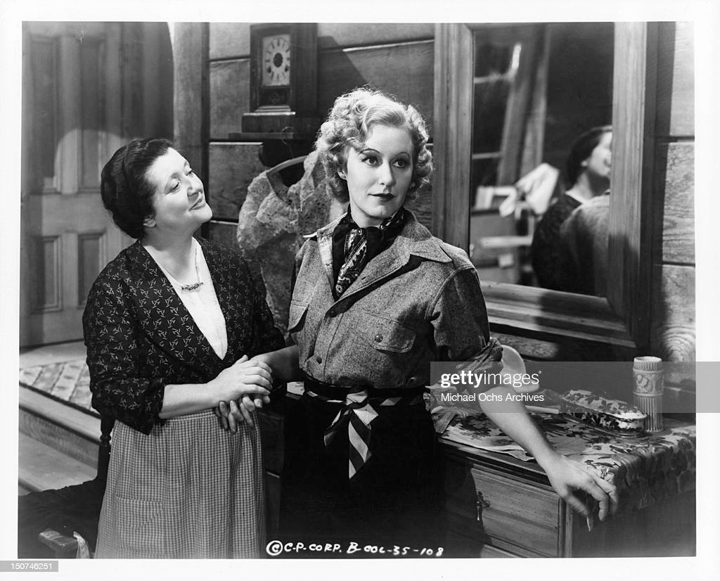 a woman is holds grace moore s hand in a scene from the film when