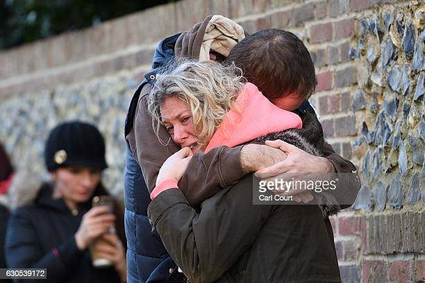 A woman is hugged as she weeps outside the Oxfordshire home of British pop singer George Michael on December 26 2016 in Goring England Singer George...